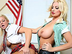 Busty nurse and innocent student get nasty in office...