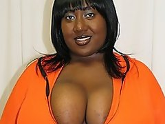 Big, beautiful, and busty black woman Ms. Squeez'em smiles for the...