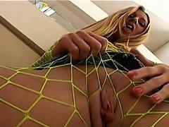 Nasty blond slut Lauren Phoenix appears in this scene wearing a...