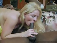 Jessica Dee brunette mouth cleaning her black hunk guy