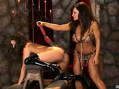 Lisa Ann spanking a hot naked babe on chair