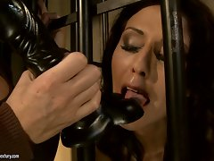 Mandy Bright sucking a black dildo of terror guard