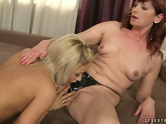 Sexy blonde strips down redheaded cougar licking clit