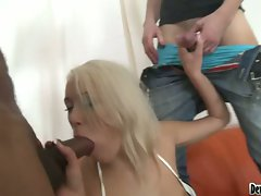 Blonde chick blows two meaty pipes alternately