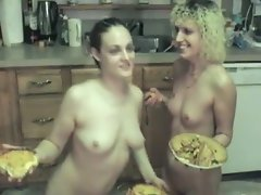 Kinky lesbians with pies smear each other messy