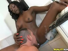 Petite Ebony minx gets eaten out in the bathtub