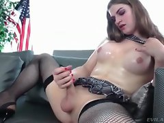 Kinky schoolgirl shemale starts stroking her long cock