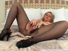 Petite blonde in pantyhose fingering her pussy