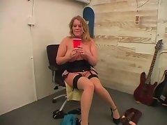 Voluptuous beauty with stockings fucking big dildo