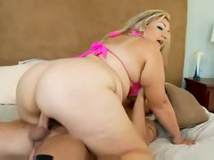 Fat girl in pink bikini top sits on cock