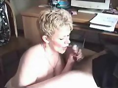 Mature wife on her knees sucks dick