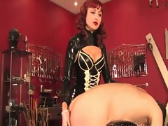 Sexy domina spanks and whips her gimp