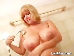 Blonde with big tits in the shower