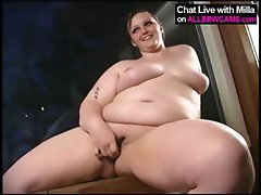 Chubby brunette with big tits poses and rubs and toys fat pussy