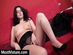 Hot brunette MILF gets naked on the couch to rub her pussy