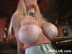 Really busty blonde stripper does her thing and then sucks cock