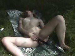 Repulsive sista with a low-down dyke snack does a dildo under a tree