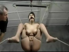 Busty German babe is tied up and bound and tortured by her master