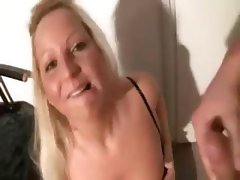 Cute German blonde is giving him a blowjob and teases in between