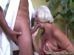 Mature granny sucking on cock for this very lucky guy