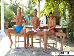 Group Teens fingering and playing outdoors