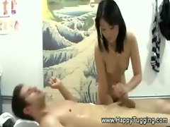 Masseuse tugs cock for her lucky client