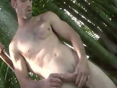 Young stud masturbating himself in the swimming pool