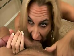 Busty mature lady titfucking and sucking cock