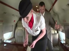 Horny stewardesses suck their clients hard cock on the plane