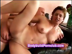 Shorthair female bodybuilder with toned body rides stiff cock then gets fucked sideways