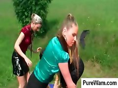 Wet and wild fun from three women washing a red can on a field