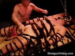 CBT my bottom is bound, gagged and hooded as I crush his balls in a clear plexiglass vise.
