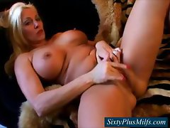 GILF with big firm breasts fingering