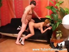Lovely Laura is banged by a masked fatty brute on a black couch