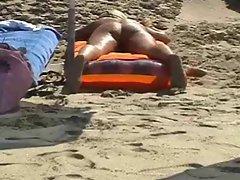Beach spread on a nude beach of a Milf