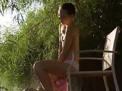 stunning thin girl fingering in a wild