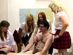 Office girls strip the office geek and wank him in CFNM scene