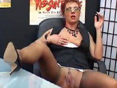 Sexy Mature Secretary smokes and fingers pussy