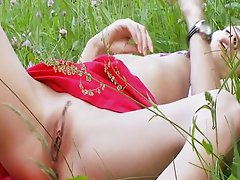 Sweet Natasha masturbates in the nature