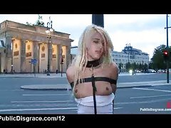 Strapped leashed blonde in the streets