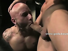 Shaved naked hunk tied and immobilized gets spanked and abused by dirty master in nasty bdsm sex