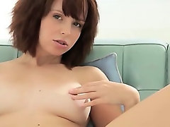 brunette dildoing her vagina on couch