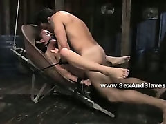 Babe with firm body tied tight in a barn and suspended in the air in deepthroat fetish sex video