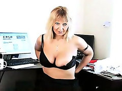 Mature secretary striptease in the office