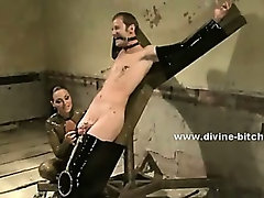 Strong male slave with huge muscles immobilized in ropes and cuffs by gang of horny mistresses