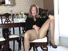 Mature gal modeling heels and pantyhose