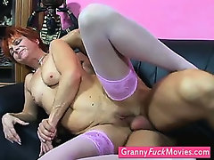 kinky GILF takes her dildo out
