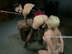 Brutal mistress forces slut to submit in bdsm lesbian sex tormenting her with electro shocks