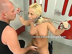 Big leather leish and rope cuffs hold blonde slut while old master gives her brutal blowjobs