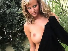 Amazingly busty blond in the forest